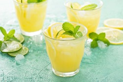 Refreshing summer citrus cocktail with lemon and lime