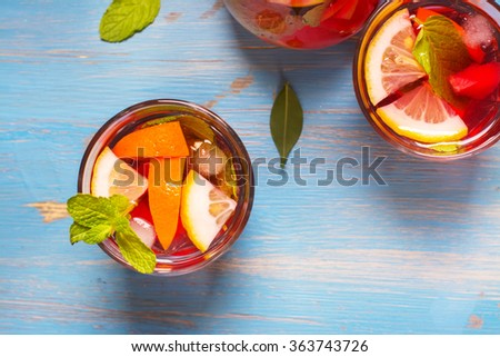 Refreshing summer cocktails with citrus fruits over blue vintage table. Top view. Selective focus
