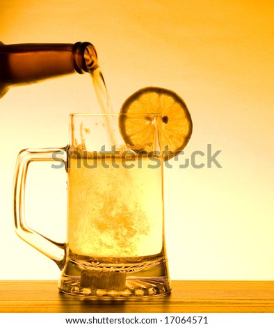 Refreshing Summer pint of beer being poured