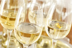 Refreshing White Wine in a Glass on a Background