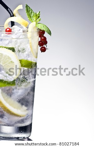 Refreshment cocktail with lemon and lime