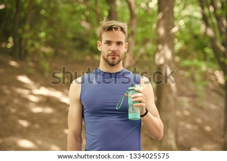refreshment. refreshment after hart sport workout. man has refreshment with water bottle. refreshment concept and healthy lifestyle. getting refreshed #1334025575
