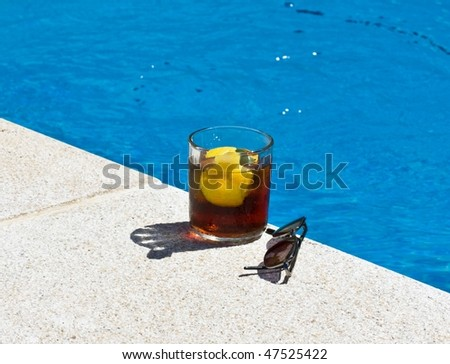 Refreshment with ice and glasses of sun in center and water outside center