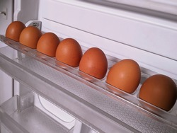 Refrigerate eggs to prevent spoilage. Selective focus.