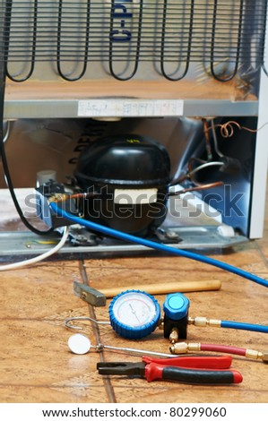refrigerator appliance troubleshooting and maintenance works background