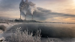 Reftinskaya GRES power station with Reftinsky reservoir in winter, Russia, Ural, January