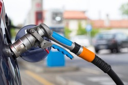 Refuel LPG. Liquid petrol gas or LPG station pump with nozzle to refuel a car.