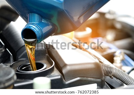 Refueling and pouring oil quality into the engine motor car Transmission and Maintenance Gear.Energy fuel concept.