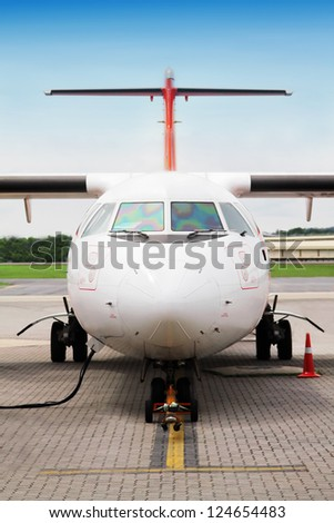 Refueling plane at the airport