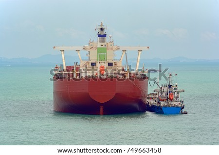 Refuelling or bunkering in marine terms is carried out using a small raid tanker to pump the bunker fuel into the bigger ship via a ship-to-ship oil transfer (STS).