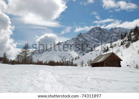 Refuge in the Alps near Briancon, Wooden huts in the snow, France