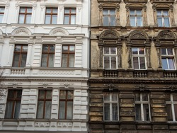 Refurbished and not renovated old building in contrast next to each other in Berlin, Germany