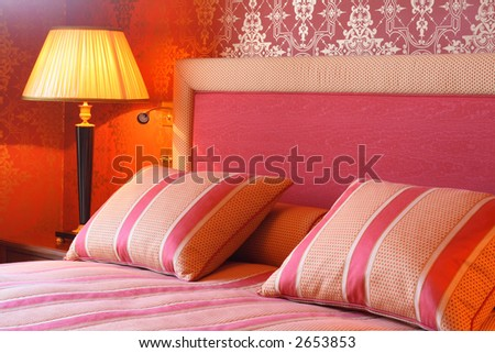 Regal bedroom with comfy pillows and duvet.