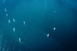 Regatta of small boats on blue lake, aerial view of Poland