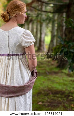 Regency woman in cream dress