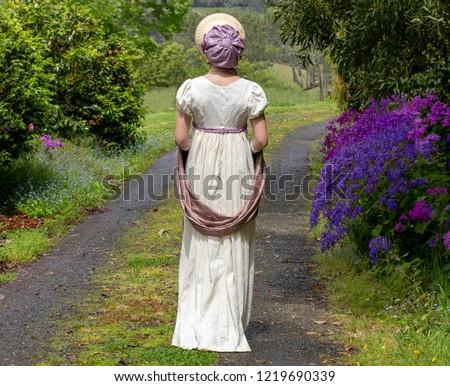 Regency woman in cream dress
