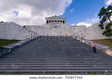 Regensburg, Germany - August 05, 2017: Young man doing sports at Walhalla memorial, hall of fame that honors laudable and distinguished people in German history.