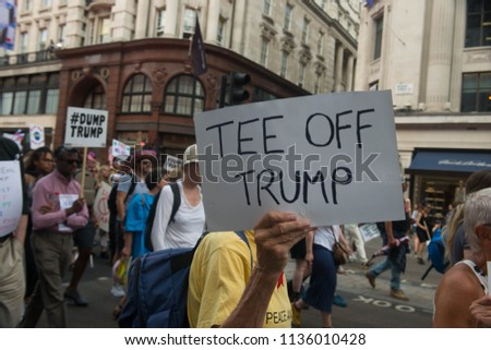 REGENT STREET, LONDON, UNITED KINGDOM. 13th July 2018. Demonstrators are seen in huge numbers holding posters during the protest against US President Donald Trumps visit to the UK  #1136010428