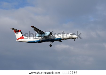 Regional passenger airplane few moments before landing - stock photo