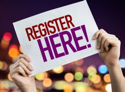 Register Here placard with bokeh background