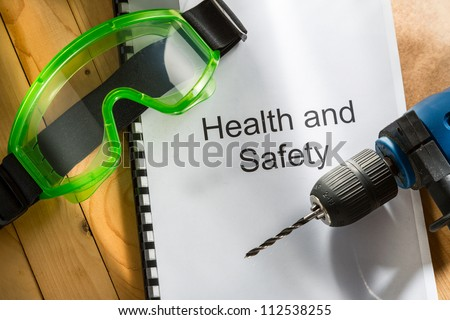 Register with drill and goggles on wooden background