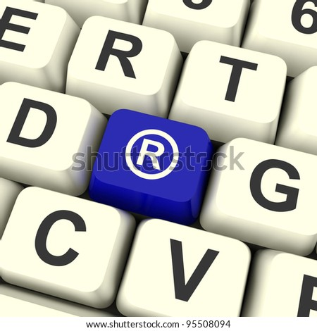 Registered Computer Blue Key Showing Patent Or Trademarks - stock photo