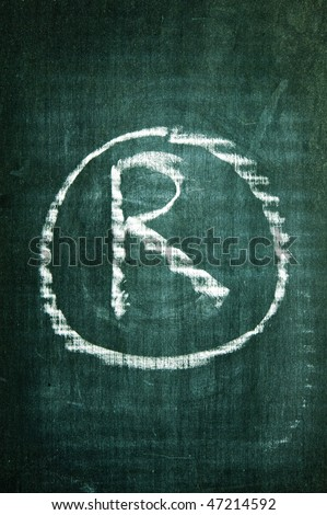 registered trademark symbol written with a chalk on a blackboard