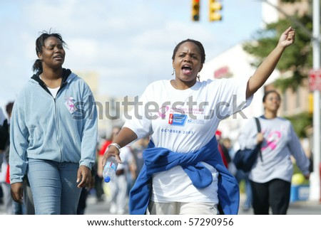 REGO PARK, NY - OCTOBER 16:  An unidentified woman gestures as she participates in the Breast Cancer Awareness Walk October 16, 2005 in Rego Park, New York.