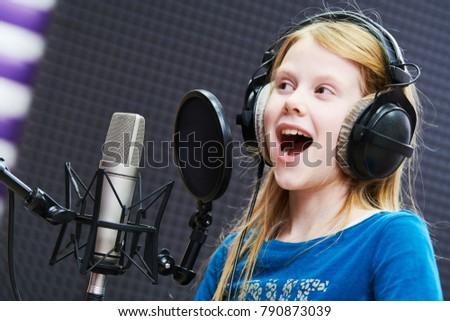 Regording studio. Child girl singing or role voicing #790873039