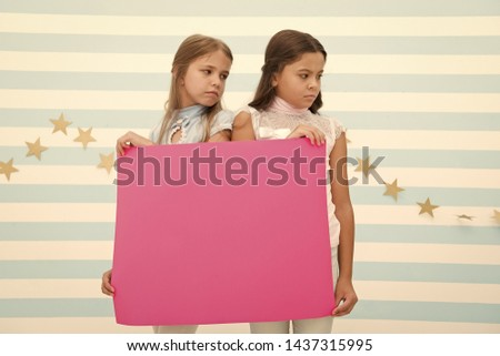 Regret to inform you. Girls hold advertisement poster copy space. Children hold advertising banner. Sad kids with blank paper advertisement. Advertisement concept. Your advertisement in good hands. #1437315995