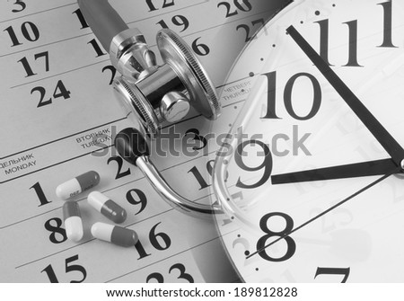 Regular medical examination concept, stethoscope on calendar and clock