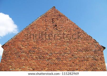 Regular shaped old brick house side photo
