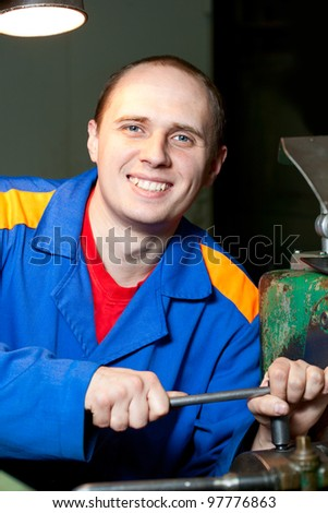Regulating of turning lathe with hands - stock photo