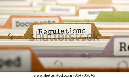 Regulations - Folder Register Name in Directory. Colored, Blurred Image. Closeup View.