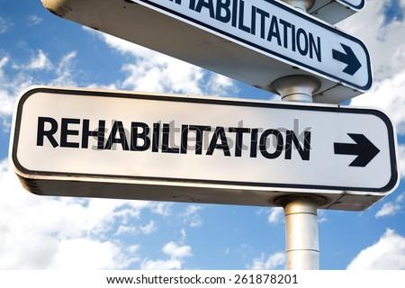 Rehabilitation direction sign on sky background