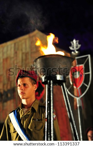 REHUVOT - SEPTEMBER 16:The memorial ceremony for fallen paratroopers force at the Monument in Tel Nof on September 16 2010 in Rehuvot, Israel.The day commemorates the deaths of Israeli soldiers at war