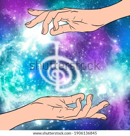 Reiki symbol. A sacred sign CHO KU REI. A hand holds Reiki CHO KU REI sign on a cosmic background. Alternative medicine. Stockfoto ©