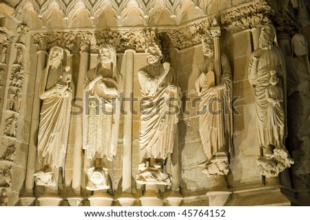 Reims (Marne, Champagne-Ardenne, France) - Exterior of the cathedral in gothic style. Facade statues by night.