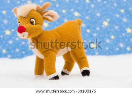 Reindeer in snow on star background, merry Christmas