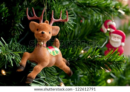 Reindeer with Santa claus on a Christmas tree. Decorated Christmas tree. - stock photo