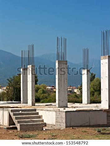 Reinforced concrete pillars on house under construction