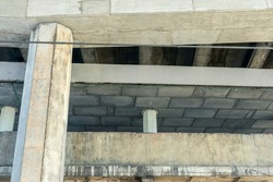 Reinforced Concrete Structure of Highway Overpass. Cracking of concrete beams under the bridge. View From Bottom Down.