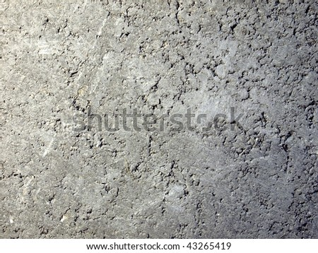 Reinforced concrete wall useful as a background