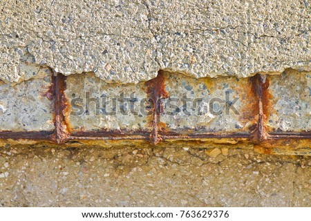Reinforced concrete with damaged and rusty metallic reinforcement #763629376
