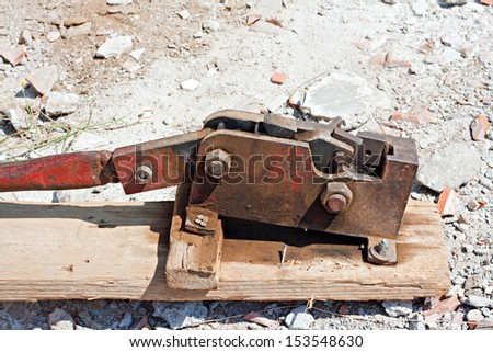 Reinforced steel rod cutter on floor of construction site
