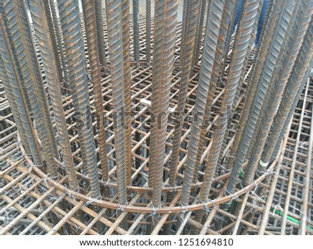 Reinforcement bars also known as rebar, known when massed as reinforcing steel or reinforcement steel. Rebar is widely used to construct reinforcement concrete such as column and deck slabs. Stock photo ©