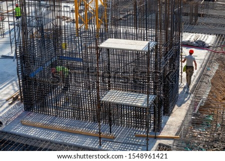 Reinforcement concrete bars with wire rod  at construction site. Building site with rebar foundation.