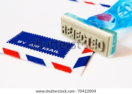 reject letter on rubber stamp with air mail envelope background