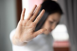 rejecting woman saying stop, no, halt with hand gesture
