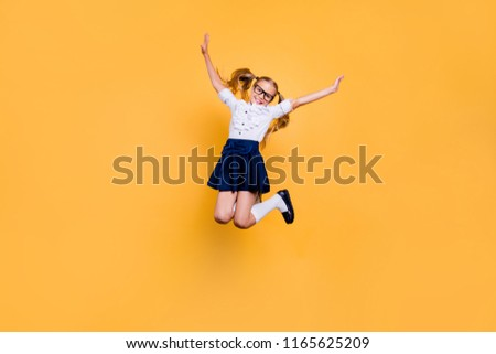 Rejoice delight enthusiasm positive laugh people person concept. Full length size studio photo of cheerful excited sweet cute clever optimistic jumping schoolchild gesturing hands isolated background #1165625209
